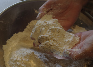 Rub in the butter until the flour looks like breadcrumbs.